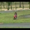 Father Clotheslines Kid On Mini Bike